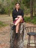 Woman Wearing Black Jacket Sitting on Tree Log Near Bar Stool Royalty Free Stock Photo