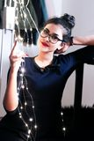 Woman Wearing Black Knit Elbow-sleeved Top Touching Mini String Lights Royalty Free Stock Photo