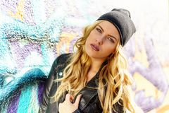 Woman Wearing Black Leather Jacket and Black Knit Cap Stock Image