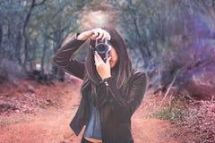 Woman Wearing Black Leather Jacket Holding Camera stock photos