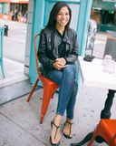 Woman Wearing Black Leather Zip-up Jacket and Blue Jeans Stock Photography