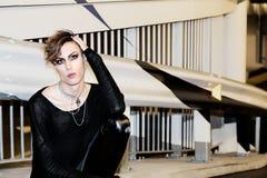 Woman Wearing Black Long-sleeved Shirt Near Grey and Black Wall stock photography