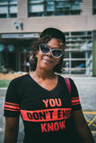 Woman Wearing Black and Orange You Don't Ever Know V Neck T-shirt and White Frame Gray Lens Cats Eye Sunglasses Royalty Free Stock Photos