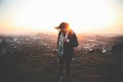 Woman Wearing Black Pants Standing for Pose on Top of Mountain during Sunset Royalty Free Stock Photography