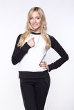 Woman wearing black pants and sweater. Beautiful young woman wearing black pants and sweater Stock Photos