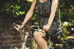 Woman Wearing Black Red and White Scoop Neck Sleeveless Mini Dress While Riding Commuter Bike Royalty Free Stock Photos