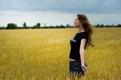 Woman Wearing Black Shirt Surrounded by Grass Stock Image