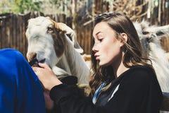 Woman Wearing Black Shirt White Goat at Daytime Stock Images