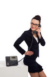 Woman wearing black skirt and jacket talking on the phone Stock Image