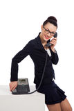 Woman wearing black skirt and jacket talking on the phone Royalty Free Stock Photography