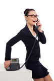 Woman wearing black skirt and jacket talking on the phone Royalty Free Stock Photos