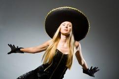 Woman wearing black. Sombrero dancing stock photography