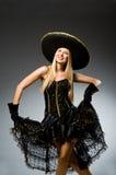 Woman wearing black. Sombrero dancing royalty free stock image