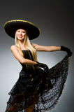 Woman wearing black. Sombrero dancing stock photo