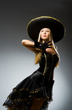 Woman wearing black sombrero Stock Image