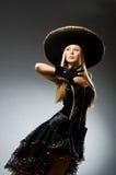 Woman wearing black sombrero. Dancing stock image