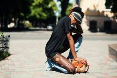 Woman Wearing Black T-shirt Kneeling on Ground stock photography