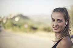 Woman Wearing Black Tank Top And White Earbuds Royalty Free Stock Photo