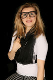 Woman wearing black and white outfit and glasses Stock Images