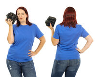 Woman wearing blank blue shirt holding camera Royalty Free Stock Images