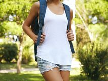 Woman wearing blank vest with backpack Royalty Free Stock Photography
