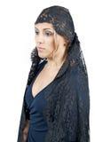Woman wearing blanket Stock Photos