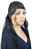 Woman wearing blanket Stock Photography