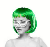 Woman wearing blinder shutter shades. Young woman with short green hair wearing blinder shutter shades Royalty Free Stock Images