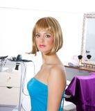 Woman wearing blond wig Stock Image