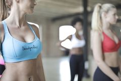 Woman Wearing Blue Beautyrobic Gym Top Royalty Free Stock Images