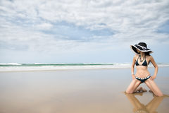 Woman wearing blue bikini on the beach Stock Photos