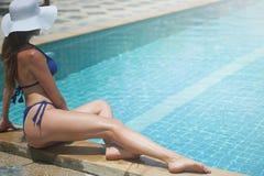 Woman Wearing Blue Bikini Set Sitting Beside Pool Royalty Free Stock Image