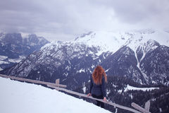 Woman Wearing Blue Bubble Coat at the Pick of the Mountain during Winter Season Stock Photos