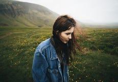 Woman Wearing Blue Denim Jacket Walking on the Green Grass Field Stock Photos