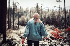 Woman Wearing Blue Denim Jacket and White Beanie Walking in the Forest Royalty Free Stock Photos