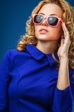 Woman wearing blue dress Royalty Free Stock Photography