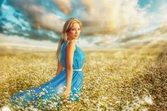 Woman wearing blue dress on filed Royalty Free Stock Photography