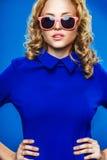 Woman wearing blue dress Stock Photos