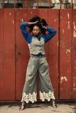 Woman Wearing Blue Dress Shirt, Gray Waistcoat, and Pants stock photo