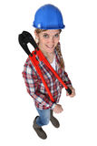 Woman wearing a blue hard hat Royalty Free Stock Image
