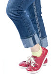 Woman Wearing Blue Jeans and Red Leather Shoes Royalty Free Stock Photo