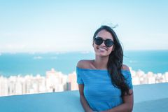 Woman Wearing Blue Off-shoulder Top Smiling stock images