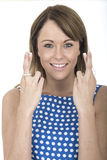 Woman Wearing Blue Polka Dot Dress Fingers Crossed Stock Photo