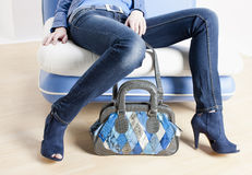 Woman wearing blue shoes Royalty Free Stock Images