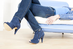 Woman wearing blue shoes Stock Photography