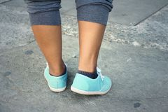 Woman wearing blue shoes at the park. Royalty Free Stock Image