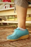 Woman wearing blue shoes at the park. Royalty Free Stock Photography
