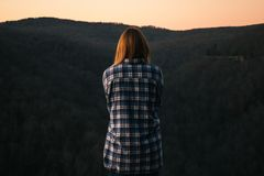 Woman Wearing Blue and White Plaid Dress Shirt in Front of Green Mountain Stock Photography