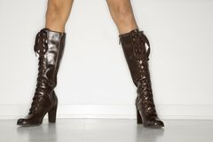Woman wearing boots. Close up of woman's legs wearing fashionable boots stock photo