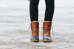 Woman wearing boots Stock Images